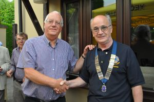 Ex Lions President Graham Marshall (Left) hands over the chain of office to new Lion President Kevin Moore
